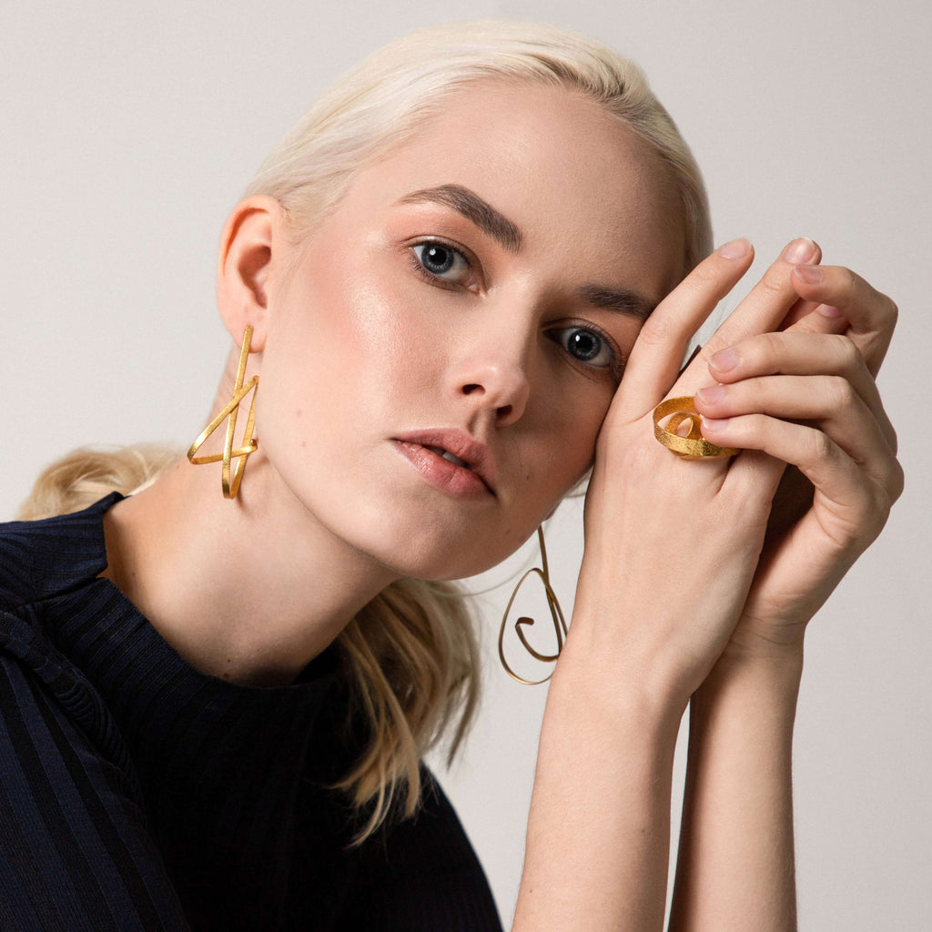 Modern statement earrings geometric irregular abstract shape contemporary design gucci dior chanel