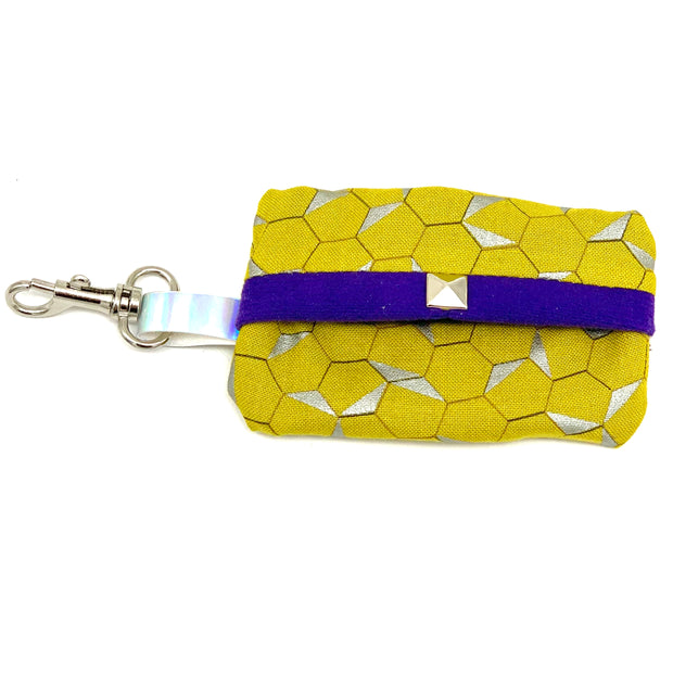 Mustard honeycomb dog waste bag holder with purple suede lining