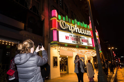 "Fans of the podcast, who call themselves ""Muderinos,"" took selfies outside the theater. CreditEmily Berl for The New York Times"