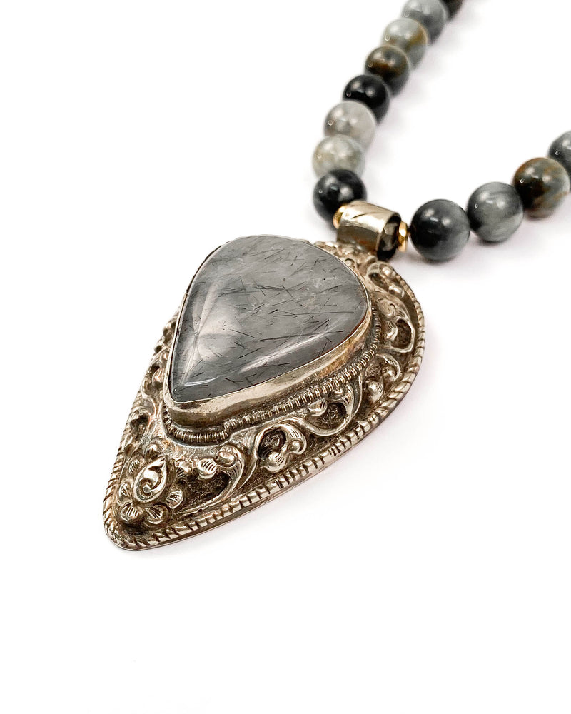 Nepali Rutilated Quartz Repousse Pendant on Hawk's Eye Necklace