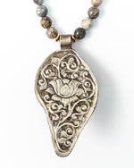 Nepal Repousse Conch Shell Pendant on Dendritic Opal Necklace