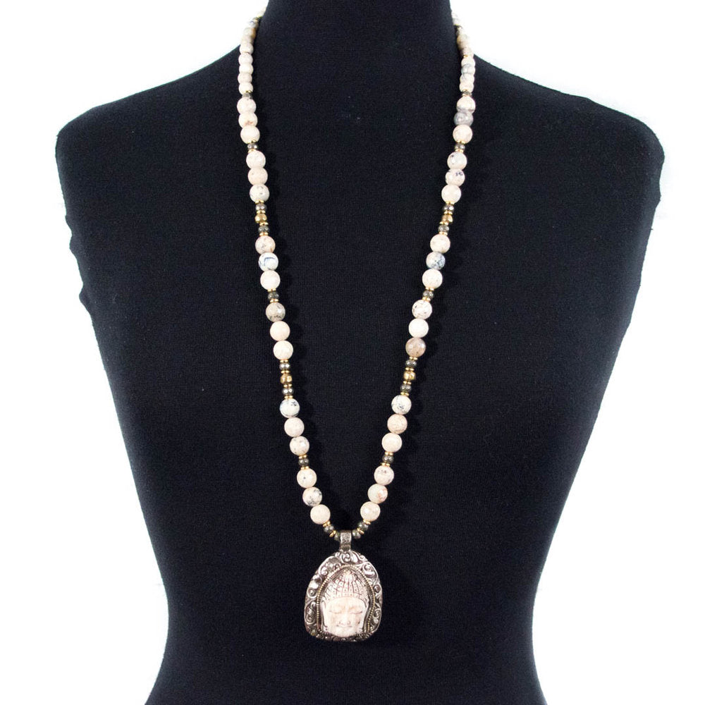 Long creamy white African opal necklace with carved Buddha pendant