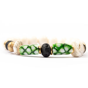 green antique Venetian millefiori glass African trade bead, lava stone, and conch shell bracelet miller mae designs