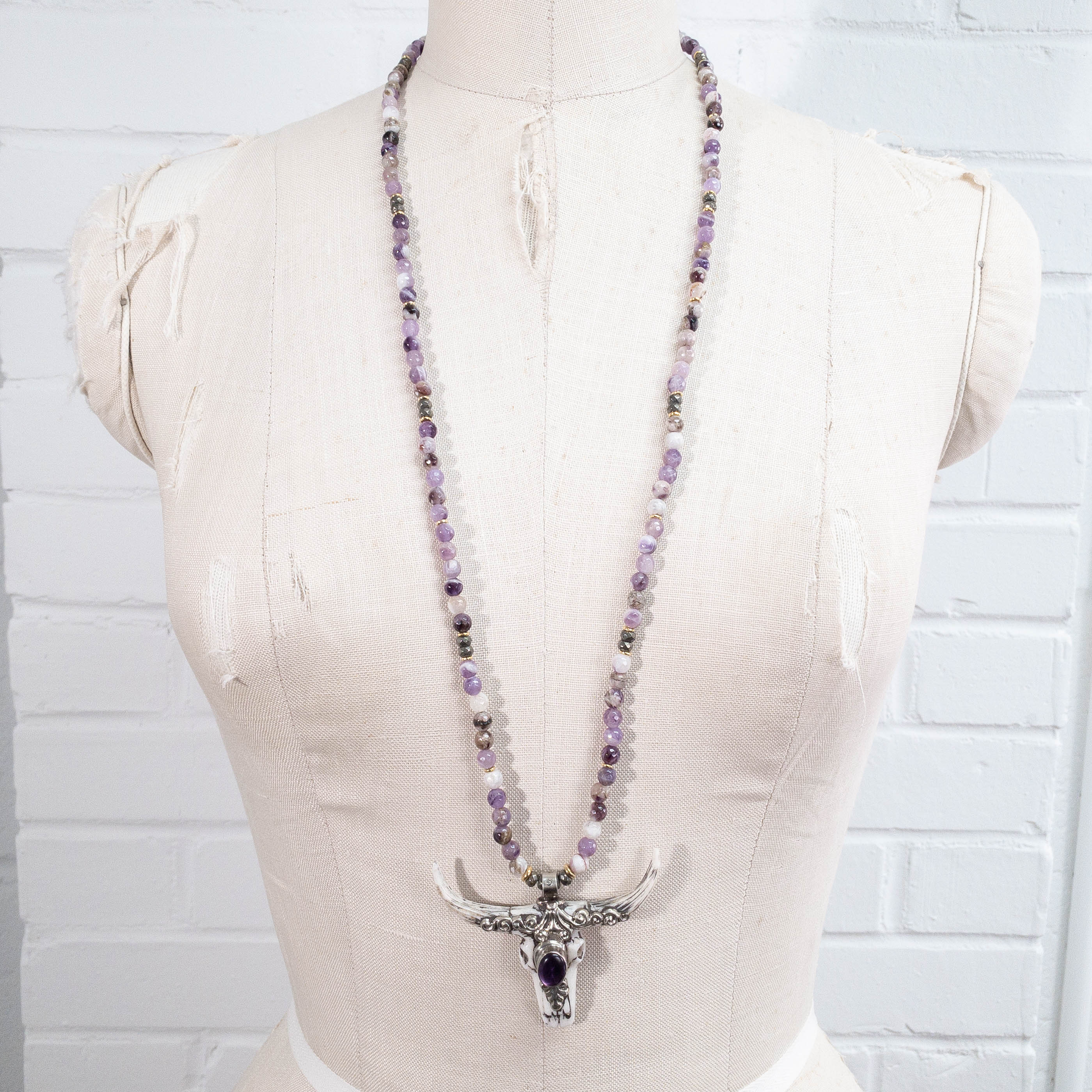 Nepali Repousse Longhorn Skull Pendant on Amethyst Necklace