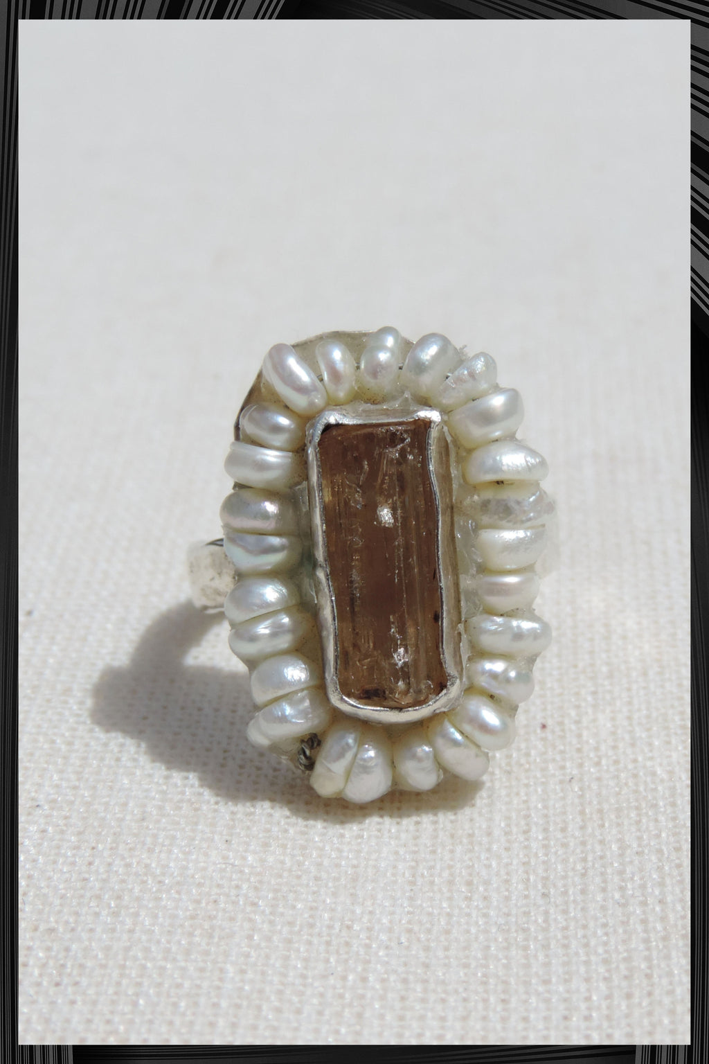 The Topaz and Pearl Ring