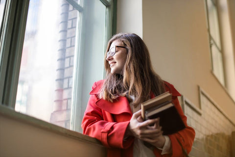 Girl holding book in her hand