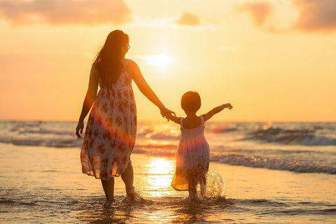 Mother & daughter at beach
