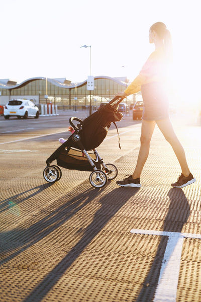 Mom walking with baby Stroller