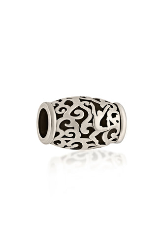 In Motion Jumping Dancer Bead. This sterling silver bead features a dancer jumping through a delicate twisting filigree pattern. Seen here in sterling silver this bead can be worn on a chain or with our signature leather charm bracelet.