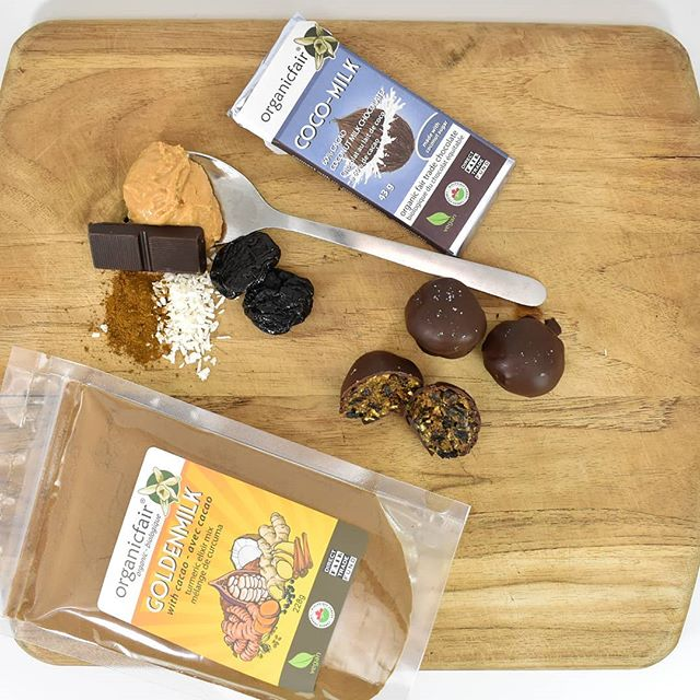 organicfair energy bites with coco-milk chocolate bar and goldenmilk elixir mix powder