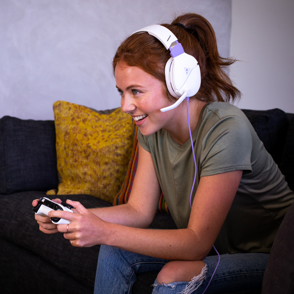 girl gaming with Turtle Beach headset