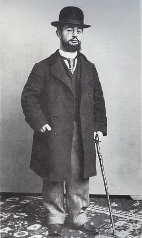 Photograph of Henri de Toulouse-Lautrec - standing with his cane and bowler hat