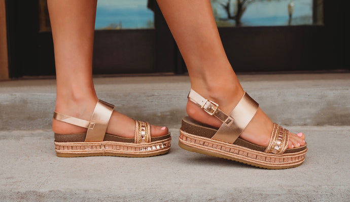 Glowing gold sandals