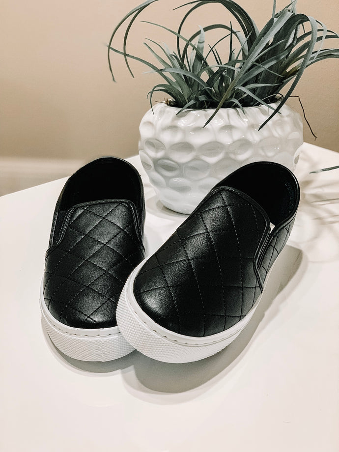 Quilted black slip ons