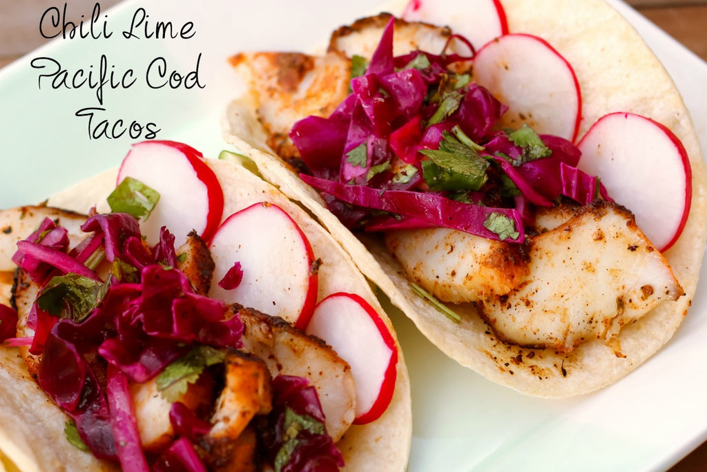 Chili Lime Pacific Cod Tacos ~ Spice rubbed and skillet cooked Pacific cod tossed with fresh lime juice in a fresh flame kissed corn tortilla and topped with a simple cabbage and cilantro slaw for the perfect south-of-the-border tasting experience.