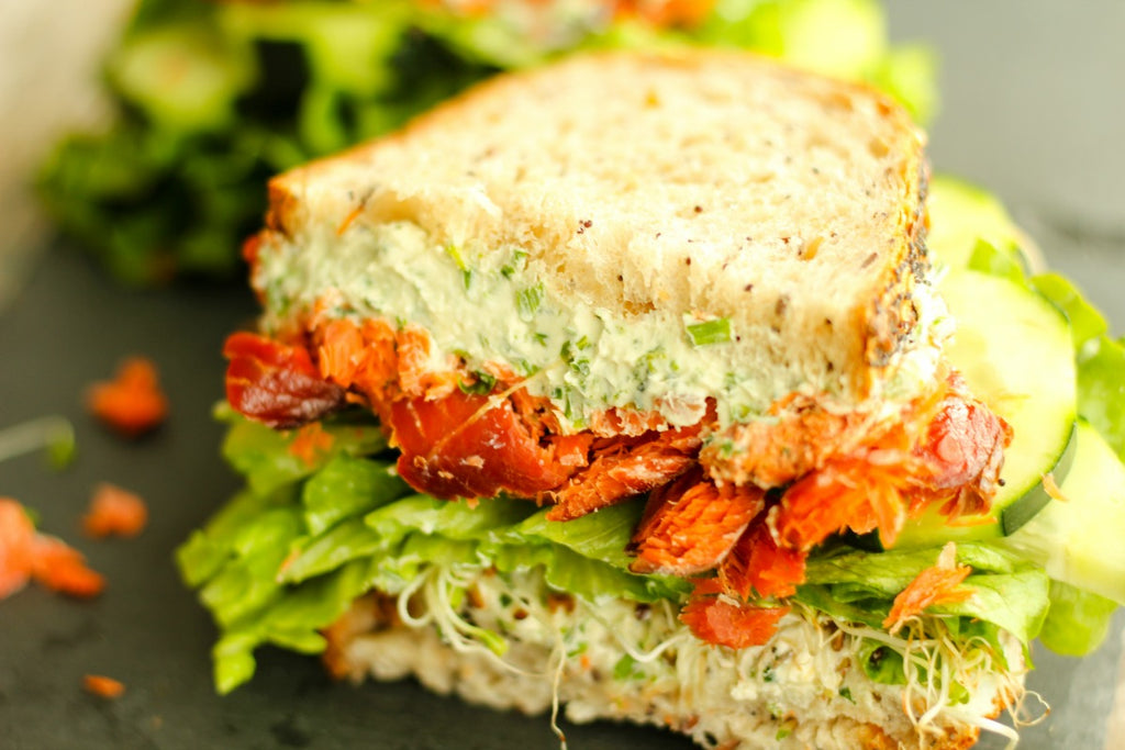 No more boring lunches with this creamy Chive and Tarragon Smoked Salmon Sandwich on a multigrain and seeded bread with fresh veggies.