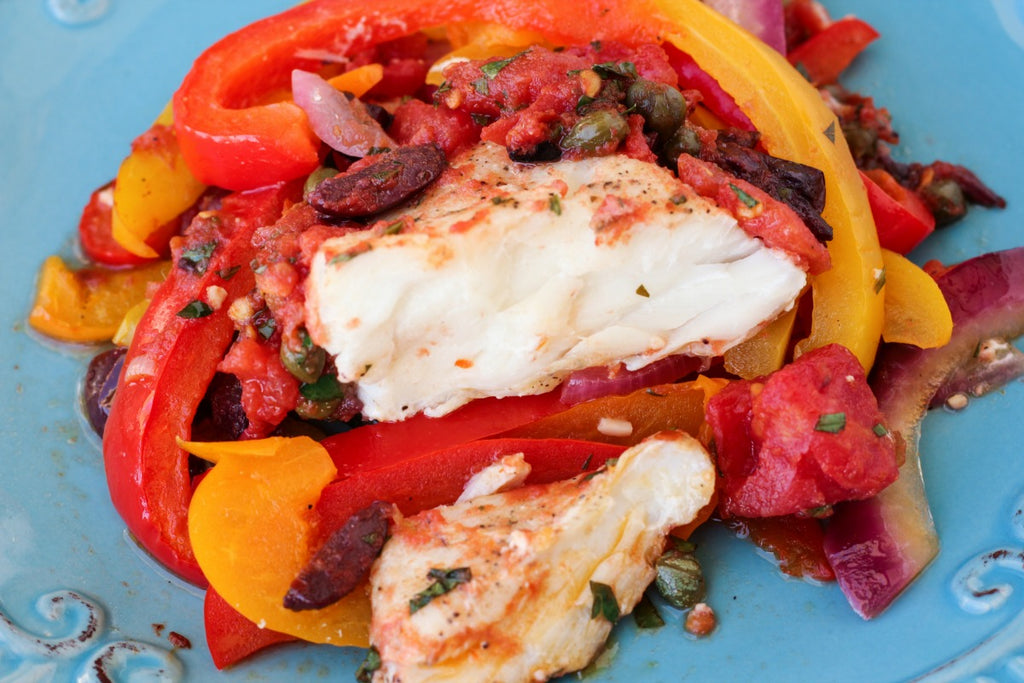 Mediterranean Halibut ~ Oven baked Mediterranean style halibut with fresh bell peppers, onions, capers, and kalamata olives.