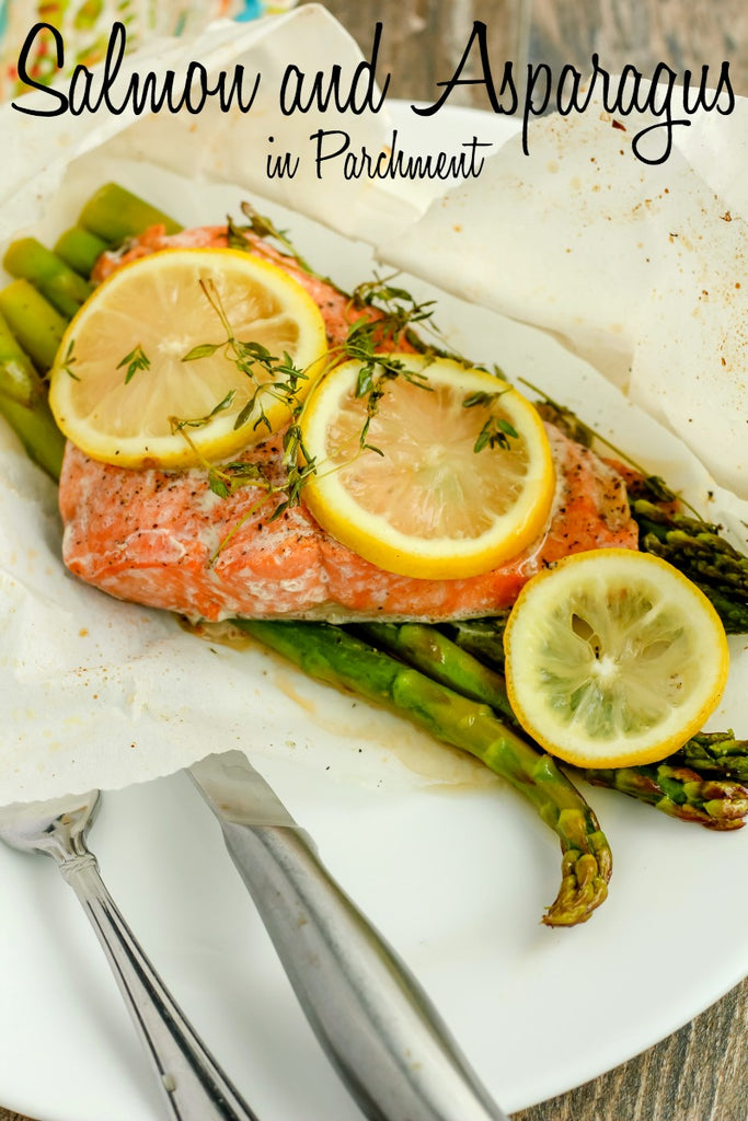 Salmon and Asparagus in Parchment ~ Sockeye Salmon delicately seasoned with salt and pepper upon stalks of crisp asparagus, topped with lemon slices and fresh thyme, sealed in parchment paper for a succulently easy and elegant dinner option.