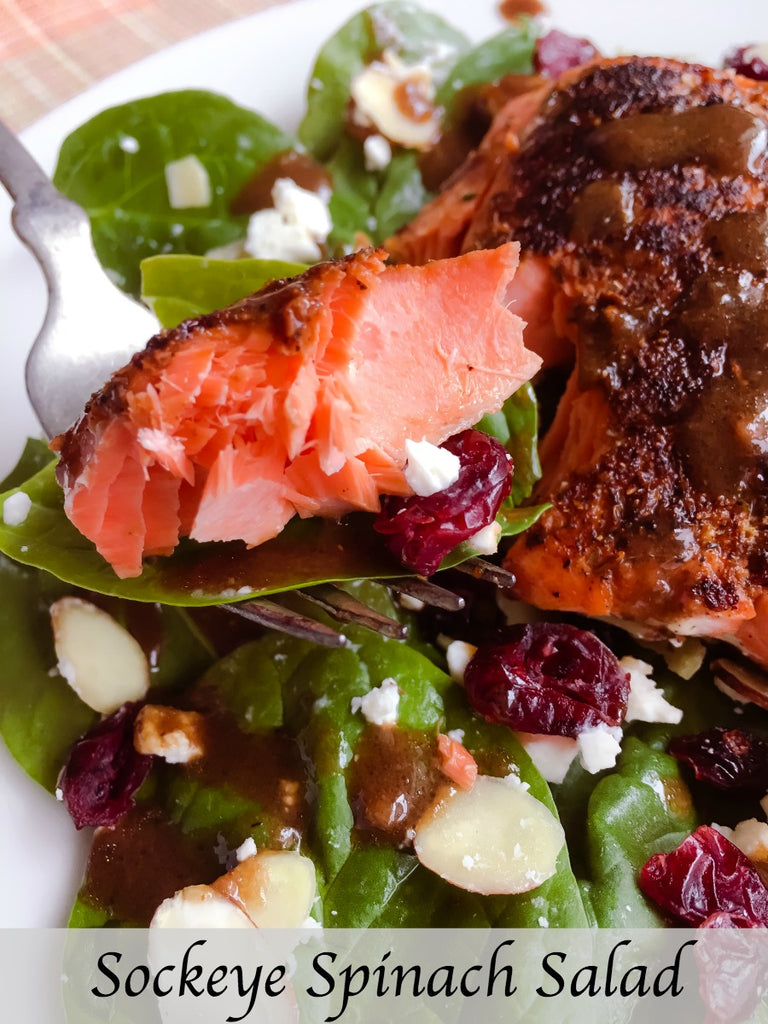Sockeye Spinach Salad is a hearty and healthy salad with seasoned seared sockeye salmon, almonds, cranberries, and feta cheese on a crisp bed of spinach greens dressed with a tangy balsamic vinaigrette.