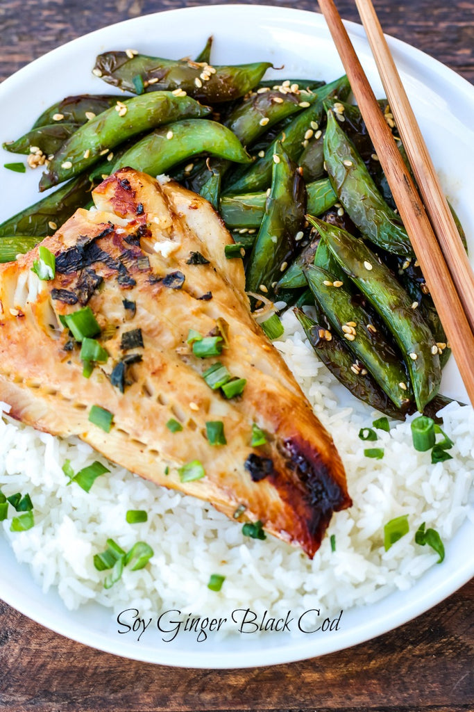 Soy Ginger Black Cod is marinaded in a slightly sweetened soy ginger sauce for at least eight hours, pan-seared, and oven-baked on high heat creating an exquisitely simple dinner.