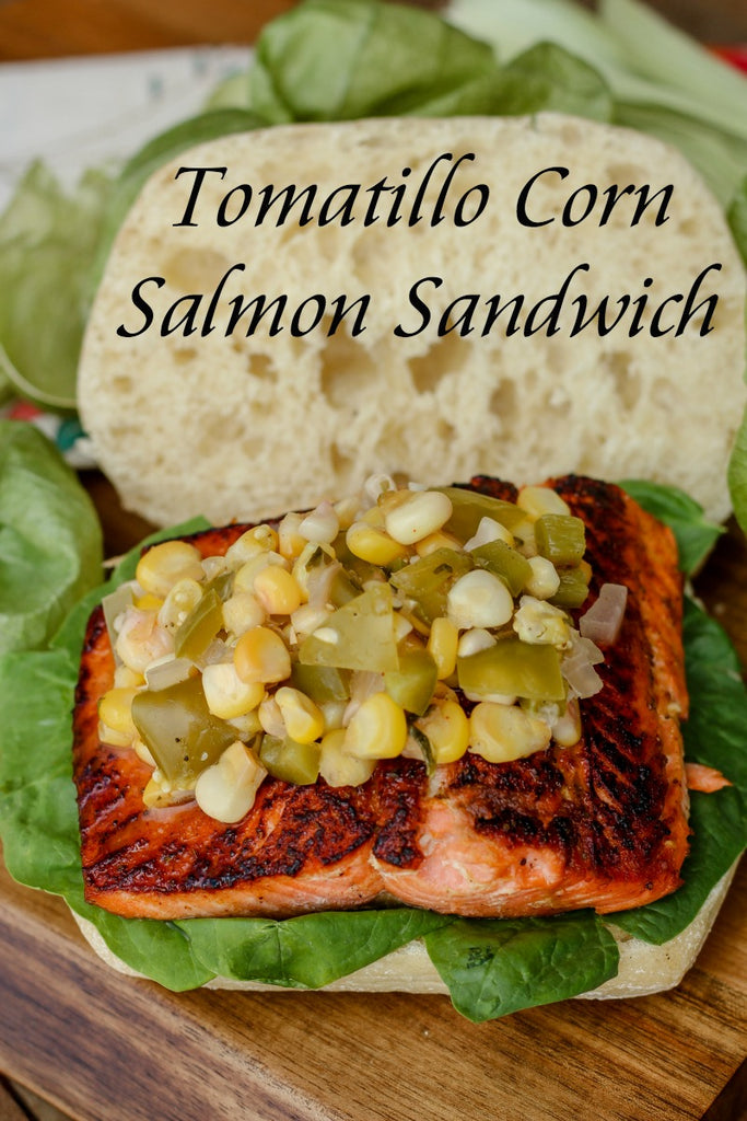 Tomatillo Corn Salmon Sandwich combines unique ingredients like a tomatillo corn relish, sustainable sockeye salmon, and Old Bay seasoning for one tasty nosh.