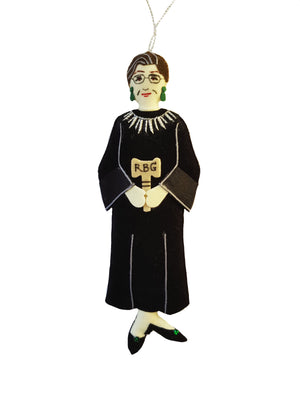 A fabric ornament of Justice Ruth Bader Ginsburg wearing her black robe, white collar, and gavel inscribed with her initials RBG