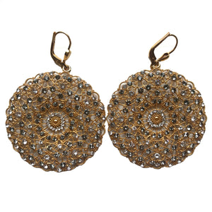 Round gold filigree earrings dotted with grey and white crystals