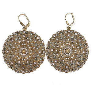 Round gold filigree earrings dotted with grey and purple crystals and white pearls