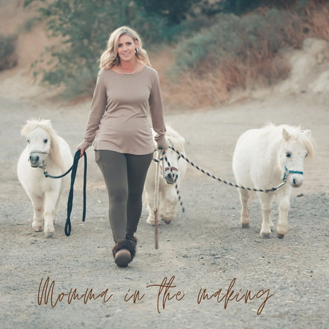 Three White Mini Horses led by Trisha CEO of Whipin Wild Rags Wearing Lounge Wear by Boutique One Twenty One