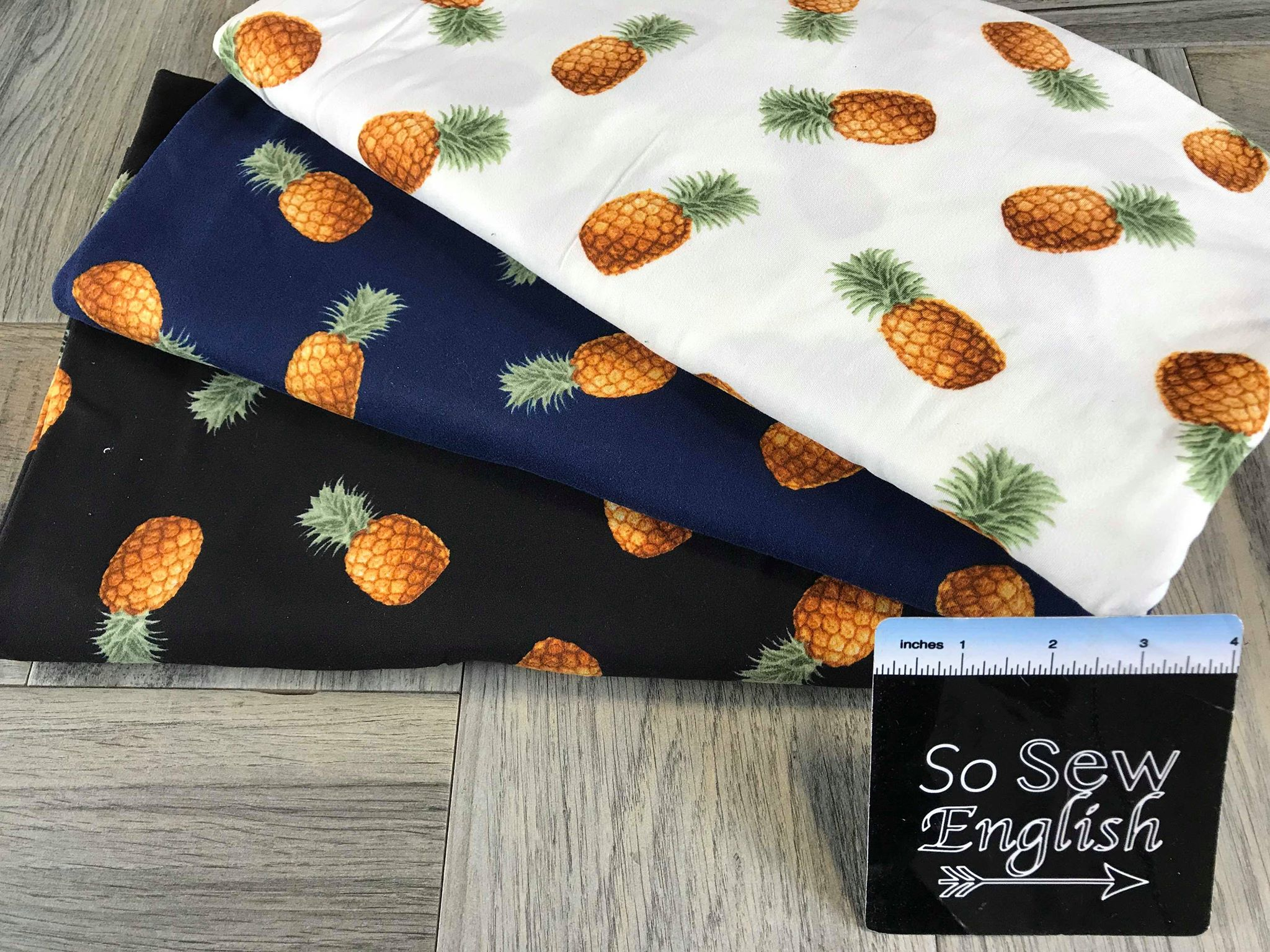 Black TOSSED PINEAPPLES - Double Brushed Poly Spandex -By The Yard