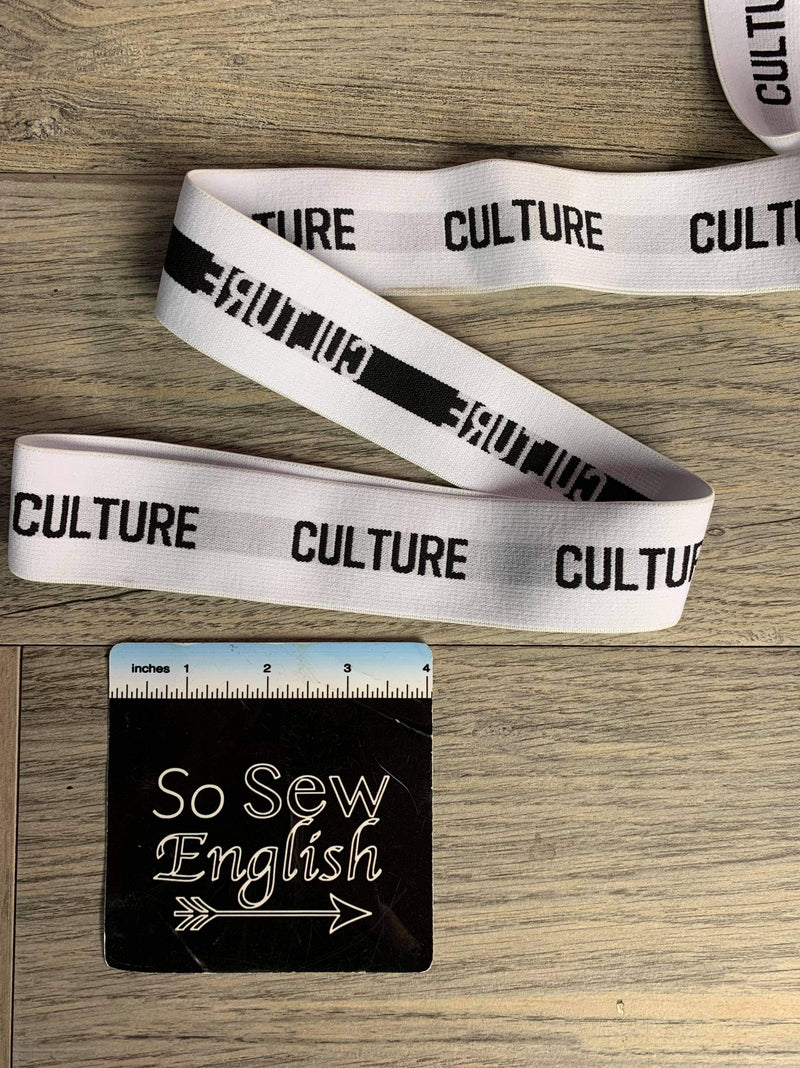 "1 1/2"" White ""Culture"" Elastic - sold by the yard"