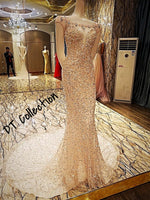 DT Collection | Sequin Wedding dress made of Polyester and Crystal. Sleeveless with short train. Mermaid design in champagne color size 2 to 16. Perfect cocktail or evening dress.