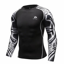 Cody Lundin Long Sleeve Compression Rash Guards. Sizes M-XXL.