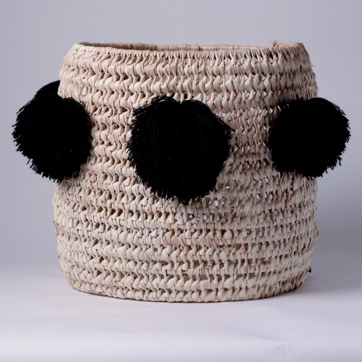 STRAW LAUNDRY BASKET, BLACK POM POM
