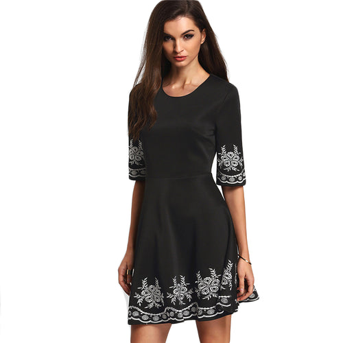 A black above the knee embroidered dress