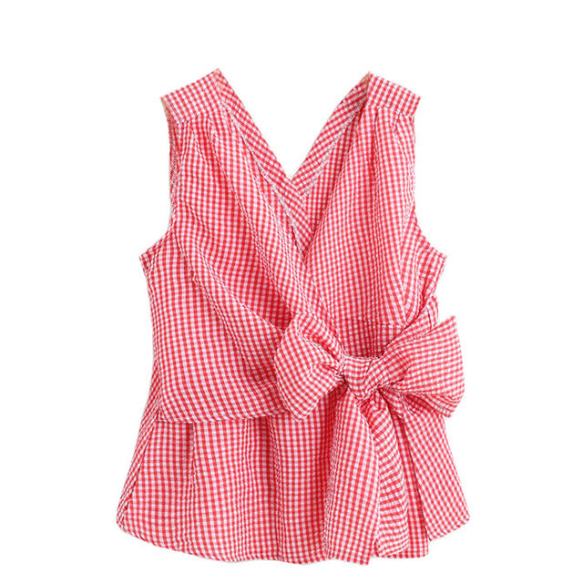 A red bow tie sleeveless blouse