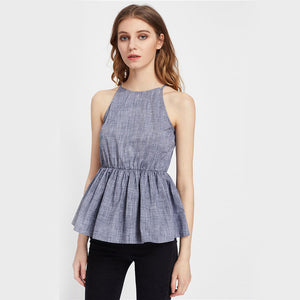 A light blue camisole with ruffles at the bottom
