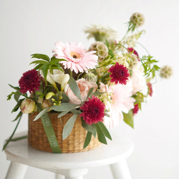 Flowers hat in a vintage woven seagrass basket - Florii Flower Studio