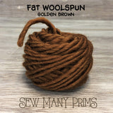 ball of golden brown wool yarn