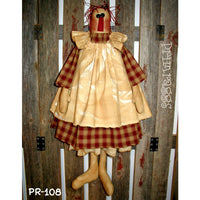 primitive raggedy Ann doll with apron