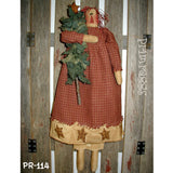 Prim rag doll holding Christmas tree
