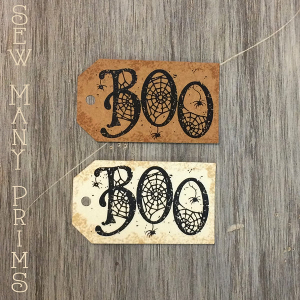 Halloween hang tags with BOO spider web letters