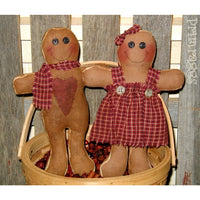 Gingerbread boy & girl fabric dolls in basket of potpourri