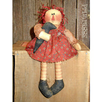 Raggedy doll sitter holding crow