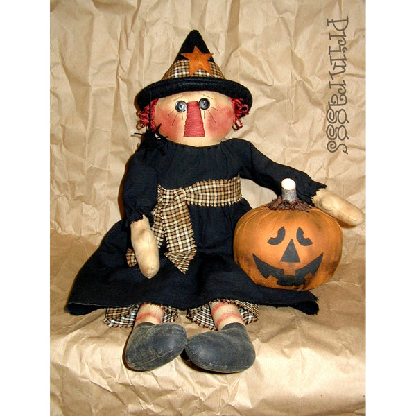 Raggedy doll witch with Jack O Lantern pumpkin