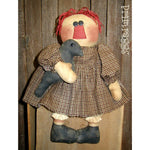 Primitive Raggedy Ann doll holding crow