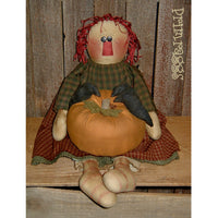 Primitive rag doll holding pumpkin with crows