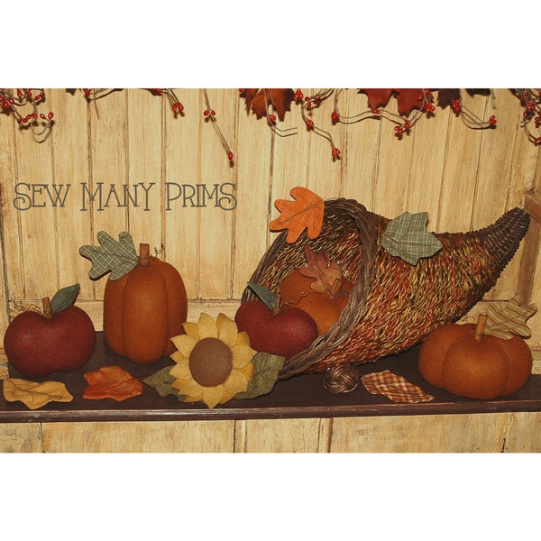 Autumn display with fabric pumpkins, sunflower, apple & fall leaves