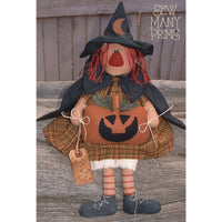 witch rag doll holding a Jack-O-Lantern pumpkin with a tag that reads BOO!