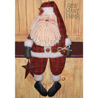 Fabric Santa doll sitting on shelf holding a tin star